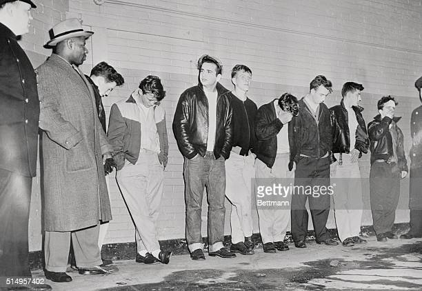 Detective Frank McLean is shown with eight youths captured while rushing a lone officer who was trying to break up a gang fight The teenage hoodlums...