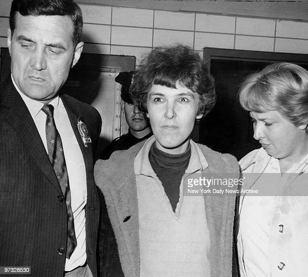 Detective Frederick Stepat and policewoman McCarthy escort Valeria Solanas into 13th pct for the shooting of Pop Art movie man Andy Warhol at his 33...