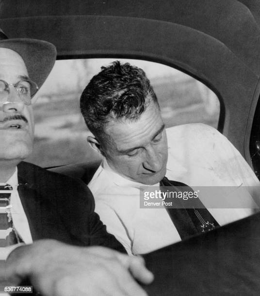 Detective George Curnow guards Willis Howard Rants of Granby after Rants' capture in a wild auto chase I through South Denver following an...