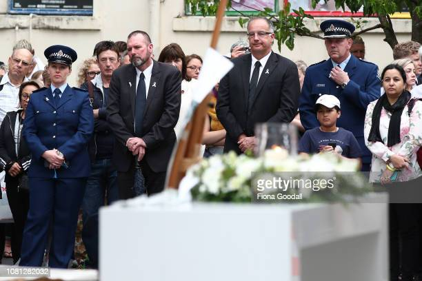Detective Inspector Scott Beard joins people gathered to honour Grace Millane in St Patricks Square on December 12 2018 in Auckland New Zealand The...