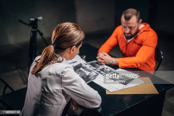 detective interrogating a prisoner in interrogation room - witness stock pictures, royalty-free photos & images