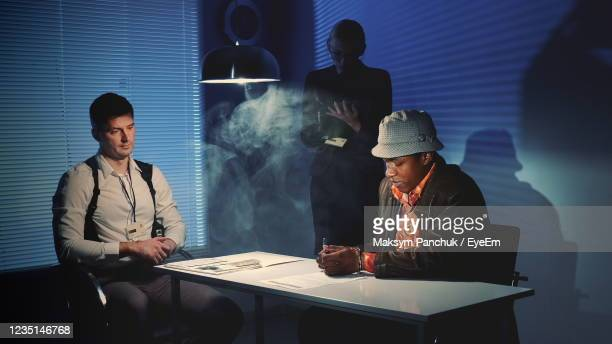 detective investigating criminal - confession law stock pictures, royalty-free photos & images