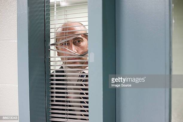 detective looking through blinds - detective stock pictures, royalty-free photos & images
