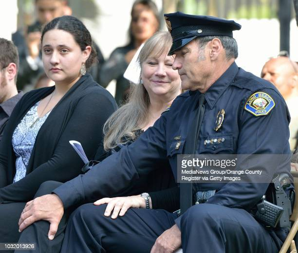 BEACH CALIF USA Detective Richard Birdsall sits with his wife Sherri Birdsall after talking about his father Officer Robert Birdsall during the Long...