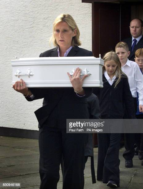 Detective Sergeant Lindsay McNair carries the tiny white coffin of Baby Carrie from an interdenominational service on the outskirts of Belfast...