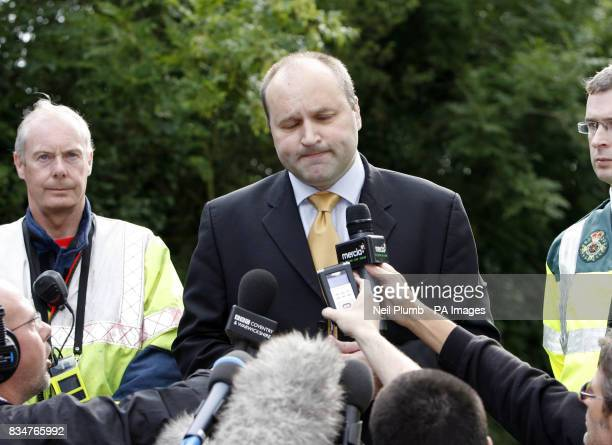 Detective Superintendent Adrian McGee of Warwickshire Police speaks to the media as police block the road leading to Coombe Abbey near Coventry...