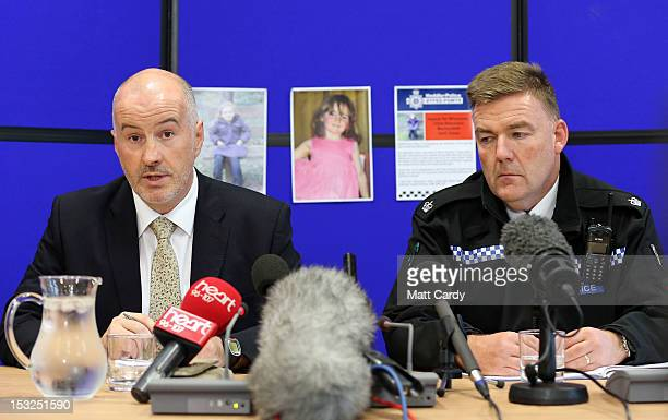 Detective Superintendent Reg Bevan and Superintendent Ian John speak to the media during a press conference into the abduction of 5yearold April...
