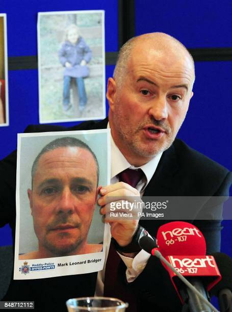 Detective Superintendent Reg Bevan during a press conference in the Welsh Government Building in Aberystwyth Ceredigion holding up a photo of...