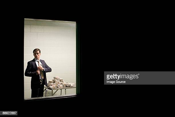 detective taking money - corruption stock pictures, royalty-free photos & images