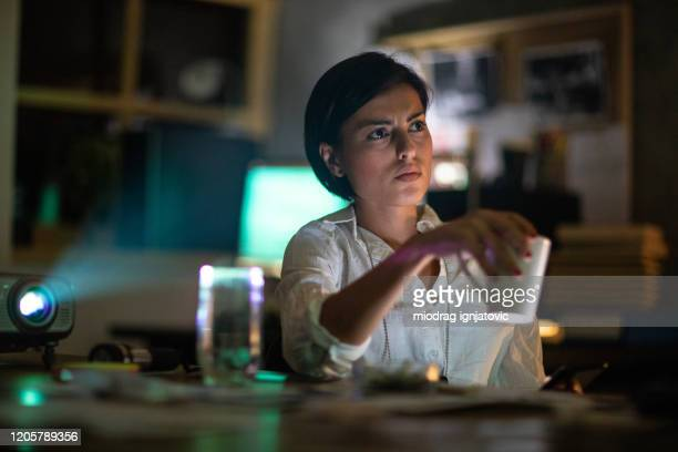 fbi detective using projector in the office - rank stock pictures, royalty-free photos & images