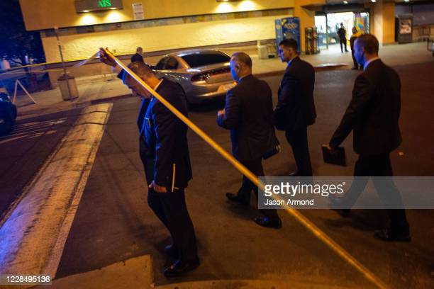 Detectives arrive at the scene where two L.A. County sheriffs deputies shot, gravely injured in attack captured on Saturday, Sept. 12, 2020 in...