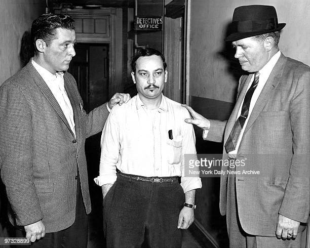 Detectives Donald Roberts and Daniel Nolan at Clinton St precinct flank mustached Ismael Perez after publication of sketch in Spanish language papers...