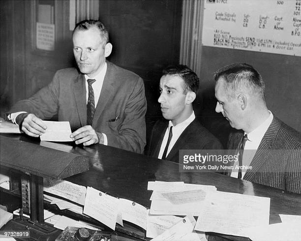 Detectives Edward McLean and Jerry Kilbane arrest and book Carmine Persico at the 67th Precinct in Brooklyn