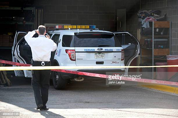 Detectives investigate an officer involved shooting at district 4 2100 South Clay St in Denver Denver Police Officers made a drug arrest May 14 2014...