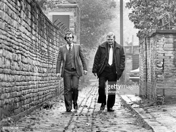 Detectives Jim Butterworth and Sergeant John Mackrill walk the Bradford alley where Barbara Leach was murdered by Peter Sutcliffe, 31st October 1979.