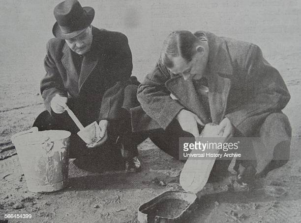CID detectives make a cast of a footprint at a crime scene England 1950