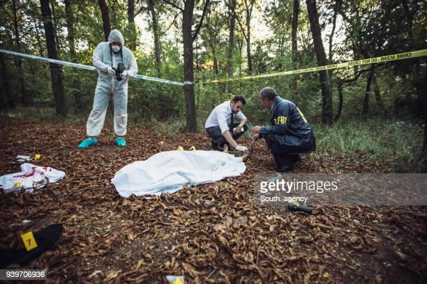 Detectives on crime scene