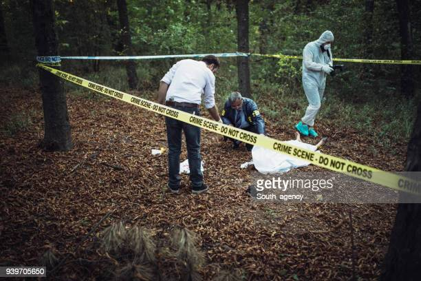 Detectives on murder scene collecting evidence