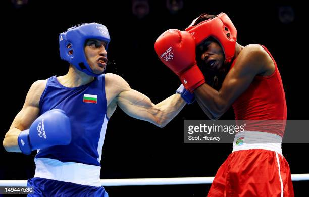 Detelin Dalakliev of Bulgaria in action with Ayabonga Sonjica of South Africa during their Men's Bantam weight bout on Day 1 of the London 2012...