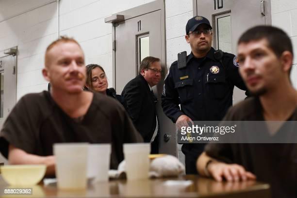 Detention bureau chief Jeff Teschner speaks to an inmates through their cell door at the Pueblo County Detention Center on Wednesday December 6 2017...