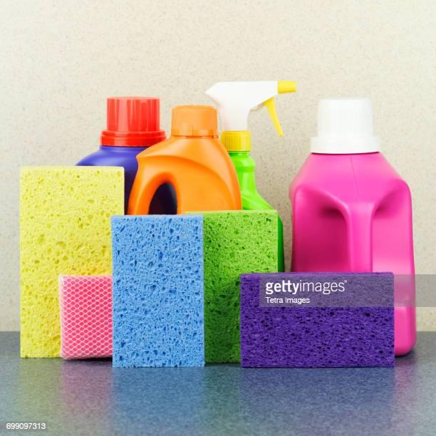 Detergent bottles and sponges