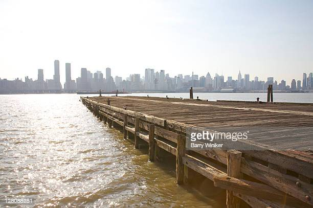 deteriorating wood pier, hudson river towards manhattan, the landings at port imperial, weehawken, new jersey, usa, march 2010 - barry wood stock pictures, royalty-free photos & images