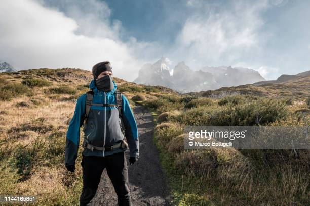 a determinated man looking away in torres del paine, chile - balaclava stock pictures, royalty-free photos & images