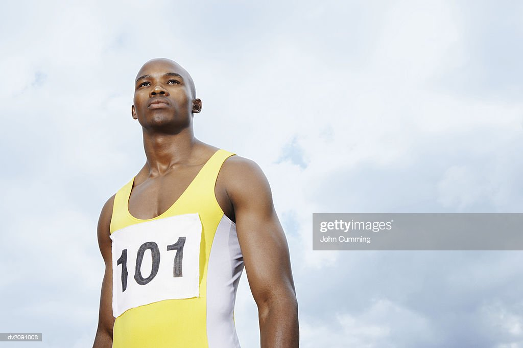 Determined Athlete Against a Cloudy Sky : Stock Photo