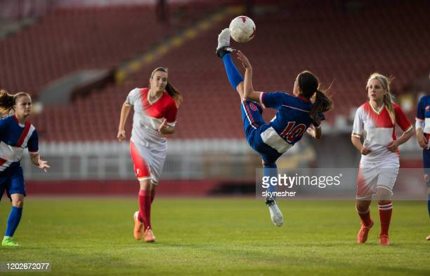 determined bicycle kick on a soccer match! - soccer competition stock pictures, royalty-free photos & images
