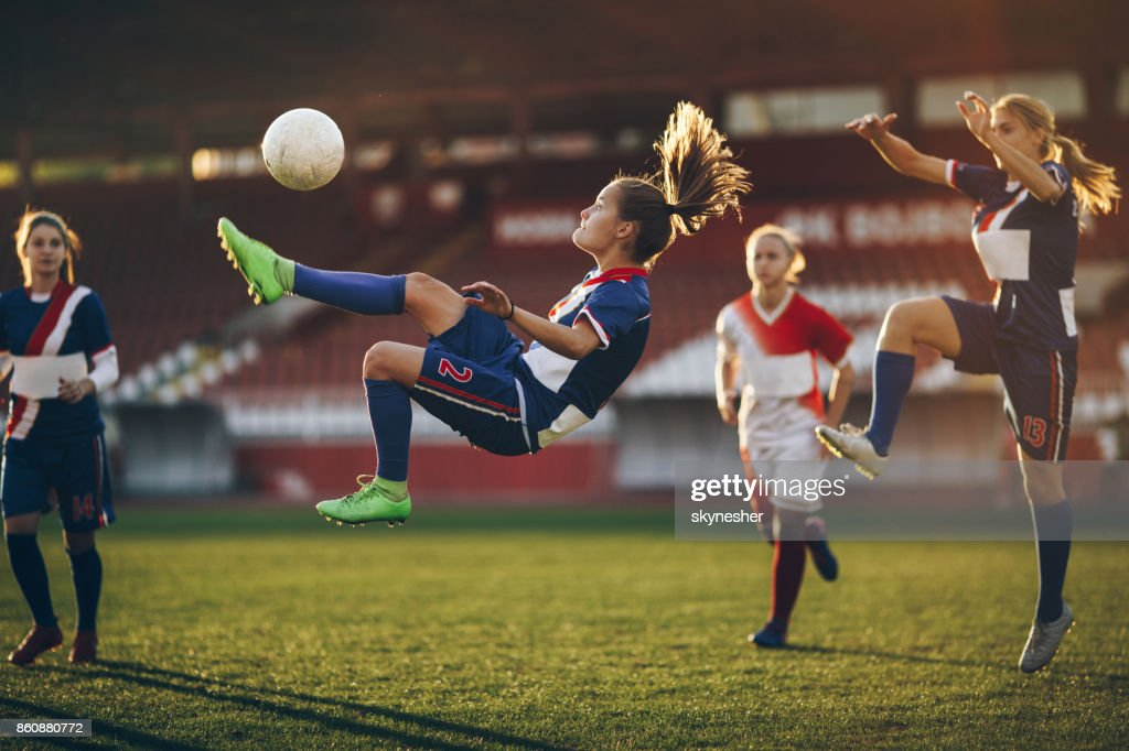 Determined bicycle kick on a soccer match! : Stock Photo