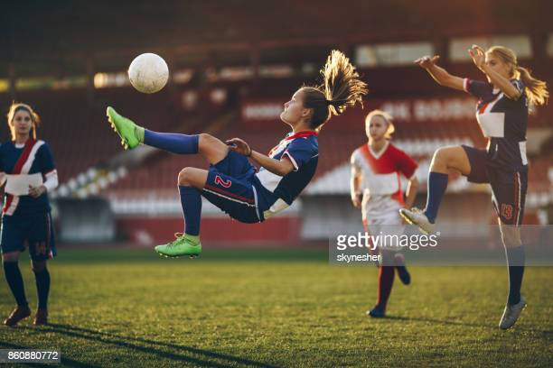 determined bicycle kick on a soccer match! - match sport imagens e fotografias de stock