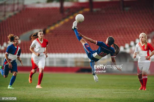 determined bicycle kick on a soccer match! - women's football stock pictures, royalty-free photos & images
