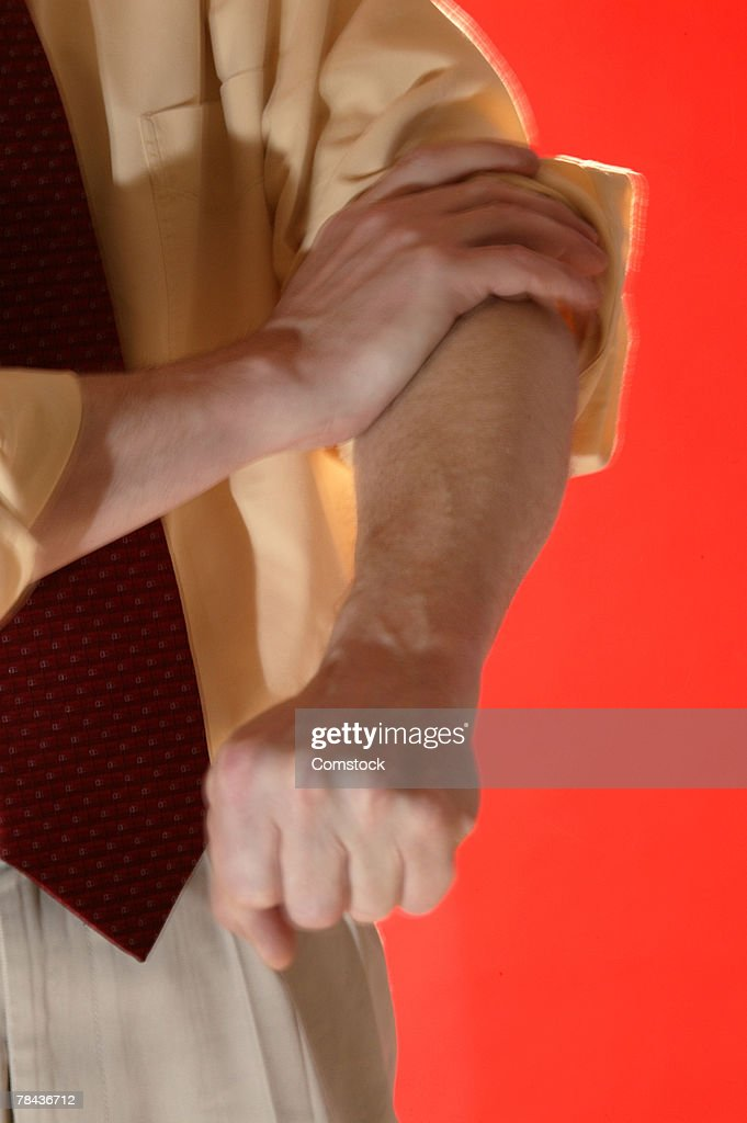 Determined businessman rolling up his sleeve : Stockfoto