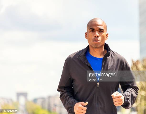 determined city runner - approaching stock pictures, royalty-free photos & images