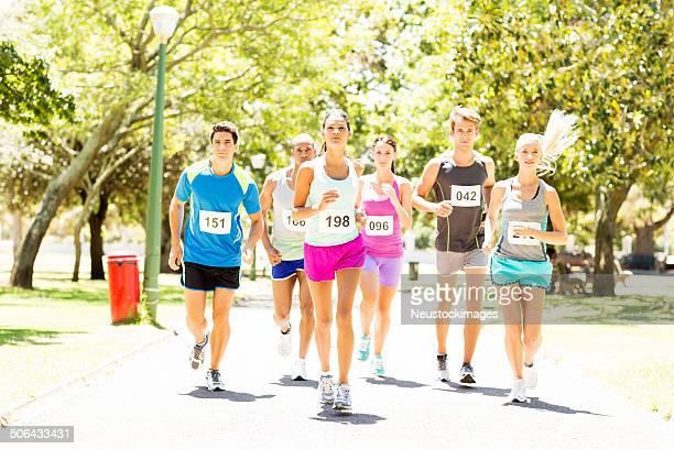 Determined Competitors Running Marathon At Park