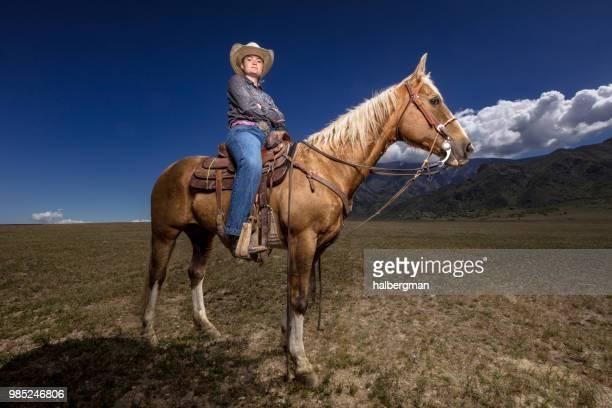 Determined Cowgirl on Horseback