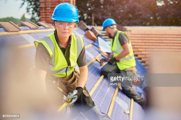 determined female roofer