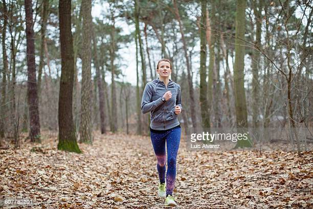 Determined female running in forest