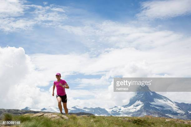 Determined female running in the mountains