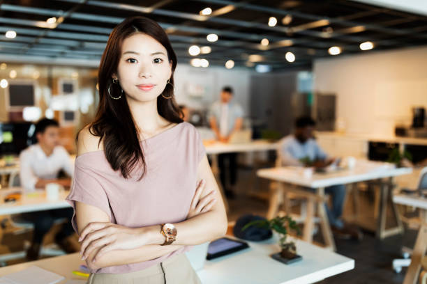 determined for success - boastful asian employee in the office stock pictures, royalty-free photos & images