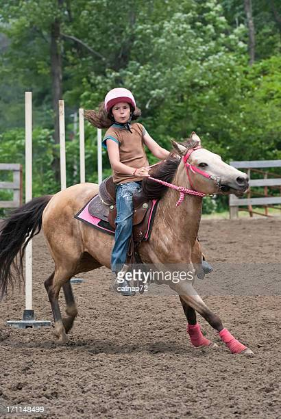 Determined Girl Riding Pony in Horse Show Event