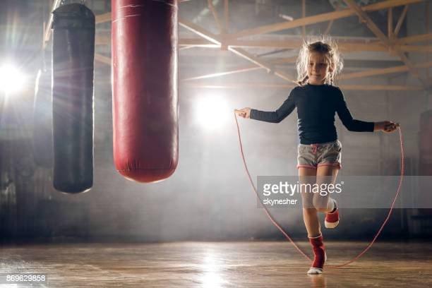 determined little girl skipping rope on sports training in a gym. - skipping along stock pictures, royalty-free photos & images