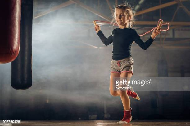 determined little girl skipping rope on sports training in a gym. - skipping along stock photos and pictures