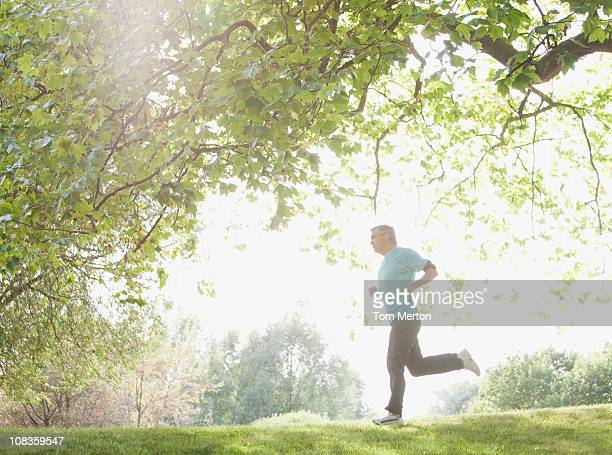 Determined man jogging outdoors