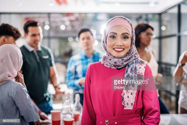 Determined mature woman with hijab is team leader