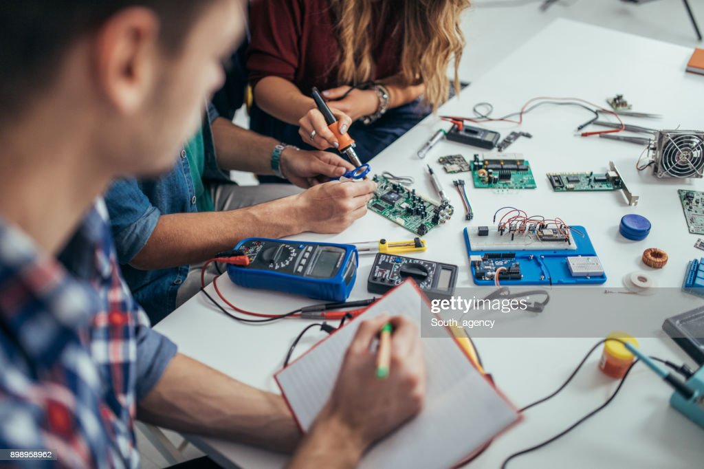 Determined students engineers : Stock Photo