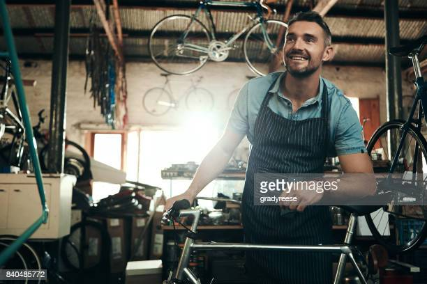 determined to provide a premium bicycle repair service - happy merchant stock pictures, royalty-free photos & images