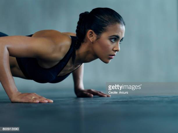 determined to reach her fitness goals - push ups stock pictures, royalty-free photos & images