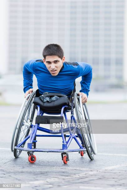 determined young man in wheelchair racing - amputee stock pictures, royalty-free photos & images