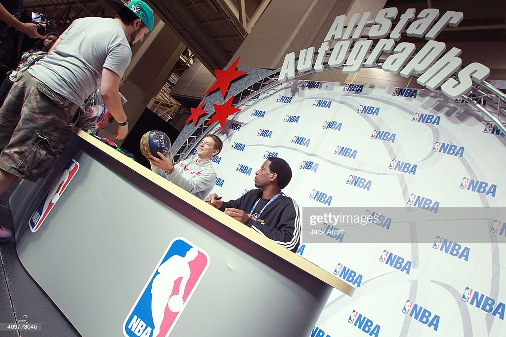 Detlef Schrempf and A.C. Green sign an autographs for a fan during the 2014 NBA All-Star Jam Session at the Ernest N. Morial Convention Center on February 15, 2014 in New Orleans, Louisiana
